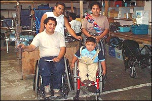 Junior with his mother Melida (right), and Alex and Hugo, two of Transitions' founders