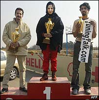Laleh Seddigh holds her trophy after a race at Tehran's Azadi stadium