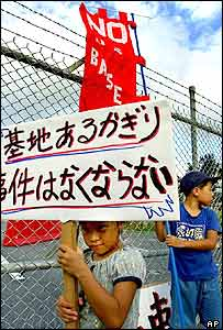 Children join a peaceful demonstration outside Kadena Air Base at Chatan in Okinawa, protesting against the U.S. military presence on the southern Japanese island Friday, July 6, 2001.
