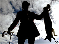 A South Durham Hunt member holds a shot fox the day after the Hunting Act came into force