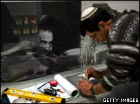 An Israeli man puts together photos of Jews in the new Holocaust Museum