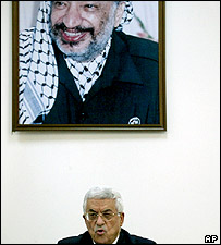 Mahmoud Abbas makes a speech under a portrait of Yasser Arafat
