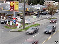 US petrol station with cars driving past