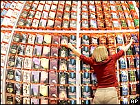 Woman arranges a book shop display