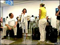 Tourists waiting for a flight at Cancun airport in Mexico