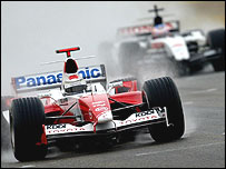Toyota's Jarno Trulli leads Jenson Button's BAR during practice at the Australian Grand Prix