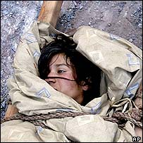 Rescued earthquake victim, Pakistan