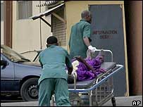 Man being wheeled into a Nigerian hospital
