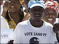 A Zanu-PF supporter in the Zimbabwean capital, Harare wearing a Zanu-PF T-shirt