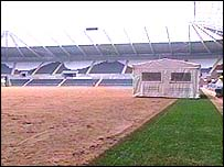 Pitch with plastic grass implanted