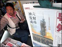 A newspaper vendor in Beijing, China