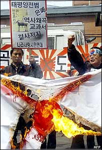 South Korean protesters burn a Japanese flag during an anti-Japan rally outside the Japanese Embassy in Seoul, 16 March 2005.