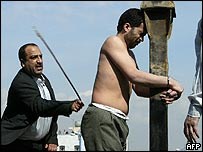 An Iranian official flogs Mohammad Bijeh before his execution