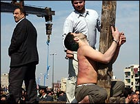 Mohammad Bijeh collapses as he is flogged before his execution
