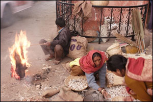 Boy burning coat in street