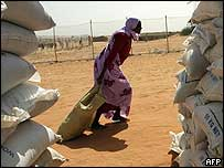 Darfur refugee with food aid