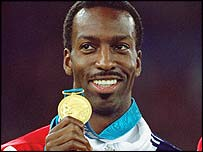 Michael Johnson celebrates winning 400m gold at the 2000 Sydney Olympics