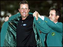 Mickelson gets his Green Jacket from 2003 Masters champion Mike Weir
