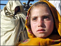 Pakistani earthquake survivors wait to be evacuated by helicopter