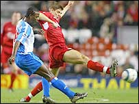 Liverpool captain Steven Gerrard beats Blackburn's Aaron Mokoena to the ball at Anfield but could not inspire his side to a much-needed win