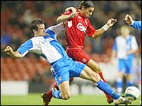 Blackburn centre-back Ryan Nelsen tackles Liverpool striker Milan Baros