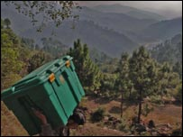 Shelterbox carried in earthquake zone. Picture courtesy of Mark Pearson, Shelterbox