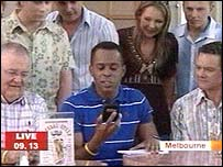 Andi Peters with the cast of neighbours
