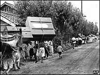 Refugees flee the village of Yongdong in Korea, July 26 1950