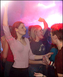 Photo of clubbers dancing and wearing hearing protection