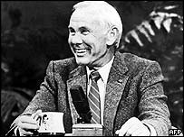 Johnny Carson with microphone on Tonight Show