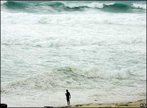 A man watches huge waves in Cancun, eastern Mexico