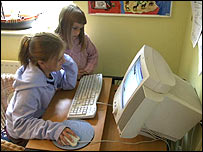 Two girls on a computer