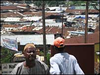 People in front of Freetown slum