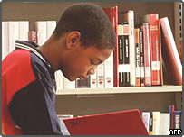Young boy reading in a library