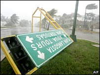 A sign is blown down by high winds in Cancun, Mexico
