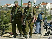 Israeli soldiers patrol a settlement in the Gaza Strip