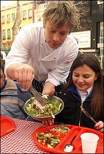 Jamie Oliver serving school dinner