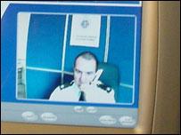 Police officer on screen in Swansea