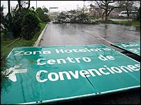 Traffic signs and trees are felled by Hurricane Wilma in Cancun, Mexico