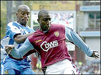 Wigan's Jason Roberts and Villa's Jloyd Samuel battle for possession