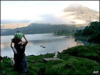 A Mayan woman carries water back to her home in Santiago Atitlan