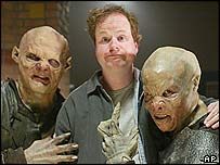 Joss Whedon with Buffy monsters