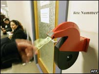 Unemployed takes number at Berlin employment office