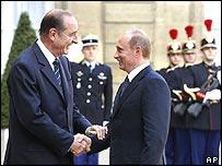 Jacques Chirac (left) greets Vladimir Putin