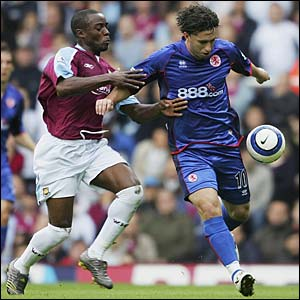 Nigel Reo-Coker battles for possession with Fabio Rochemback
