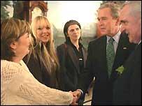 Paula McCartney shakes hands with US President George Bush