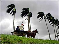 A cart moves through strong winds in Cuba's Pinar del Rio province