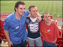Charlton striker Dennis Rommedahl (c) with Luke Grant (l) and Aaron Wall (r)