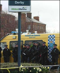 Police outside Derby railway station (PA)