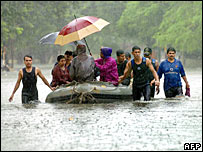 Indian divers and social workers carry out a rescue operation in Mumbai